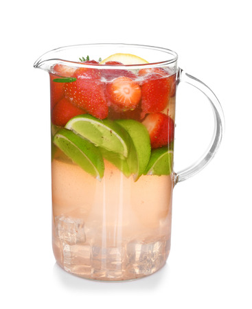 Glass jug of cold lemonade on white background 免版税图像
