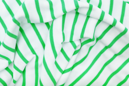 Green and white striped fabric, closeup