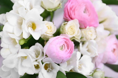 Beautiful bouquet with white freesia flowers, closeup