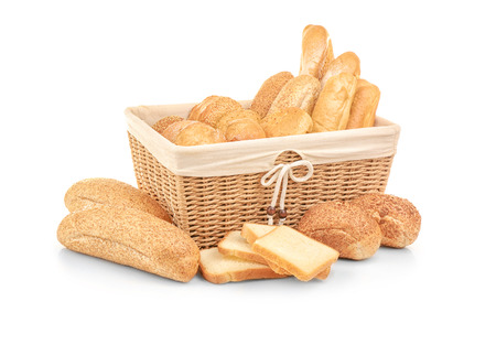 Beautiful composition with wicker basket and different bread 版權商用圖片