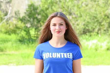 Young beautiful girl standing outdoors. Volunteering concept Stock Photo