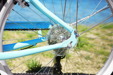 Closeup view of wheel spokes on blurred background