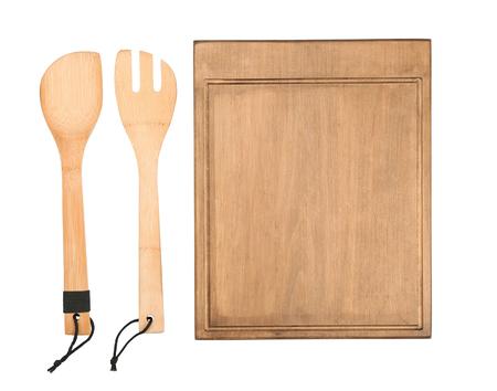 Wooden board and utensils on white background Reklamní fotografie