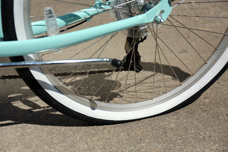 Closeup view of bicycle flat tire on pavement Stock Photo