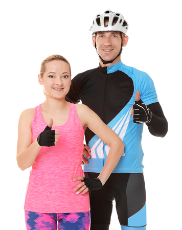 Young sporty cyclists on white background
