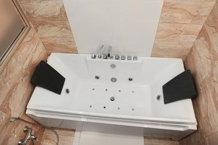 Hydro massage bath in modern spa center Imagens