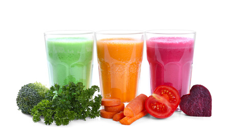 Fresh juices in glasses with ingredients on white background