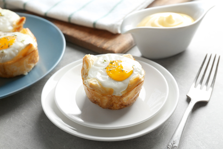 Tasty baked egg in dough on plate