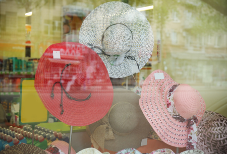 View through showcase on hats in shop