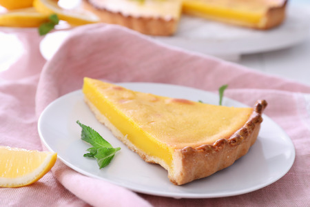 Plate with delicious lemon pie on table, closeup 免版税图像