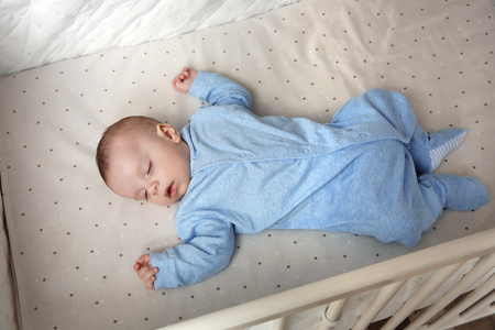 Cute little baby sleeping in cradle at home Stock Photo
