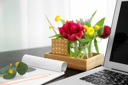 Beautiful fragrant flowers as floral decoration on workplace