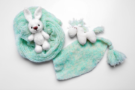 Handmade knitted toys with baby clothes isolated on white Reklamní fotografie