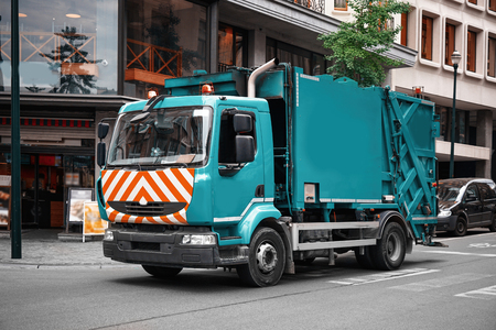 Garbage truck on city street. Ecology concept