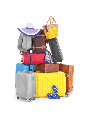 Pile of different heavy luggage on white background. Overweight concept Imagens - 112094022