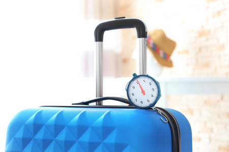 Scales on heavy suitcase. Luggage overweight concept