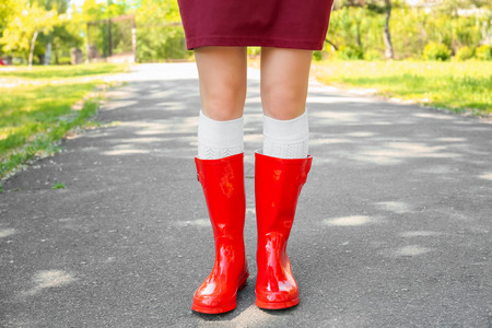 Young woman in red wellington boots outdoors Stock fotó