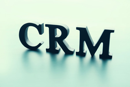 Management abbreviation CRM made with letters on light background
