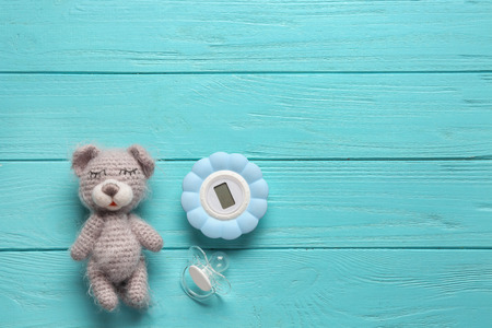 Composition with baby toy and accessories on wooden background Stock fotó