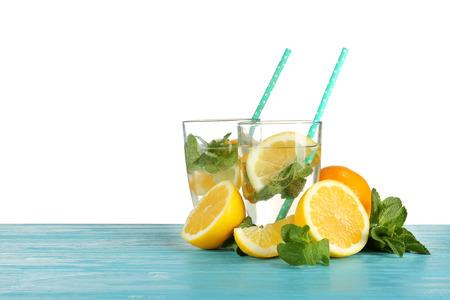 Glasses of fresh citrus lemonade on white background Stock fotó