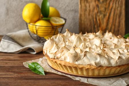 Tasty lemon meringue pie on wooden table, closeup Stock Photo