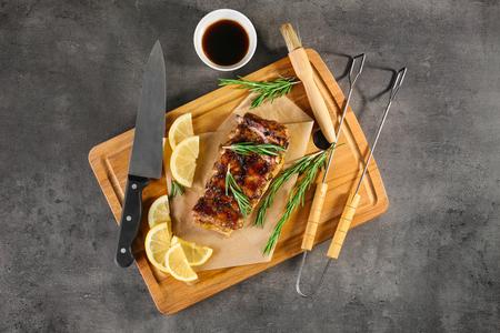 Composition with tasty pork ribs on table