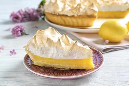 Piece of delicious lemon meringue pie on plate