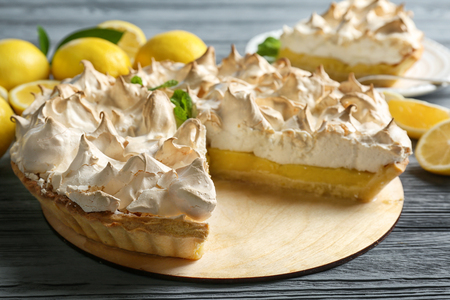 Yummy lemon meringue pie on wooden table
