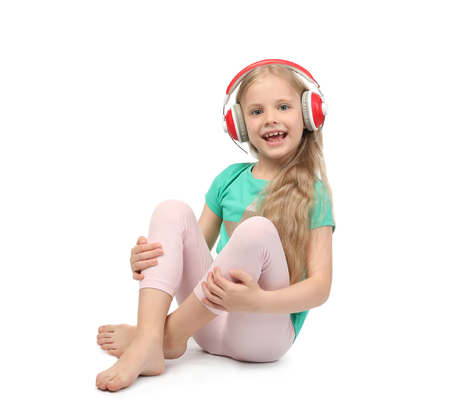 Cute funny girl with headphones listening to music on white background Stok Fotoğraf