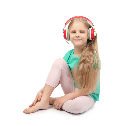 Cute funny girl with headphones listening to music on white background Banque d'images
