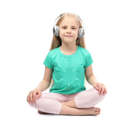 Cute funny girl with headphones listening to music on white background Archivio Fotografico