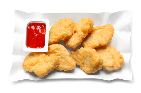 Tasty nuggets and sauce for chicken on white background Stock Photo