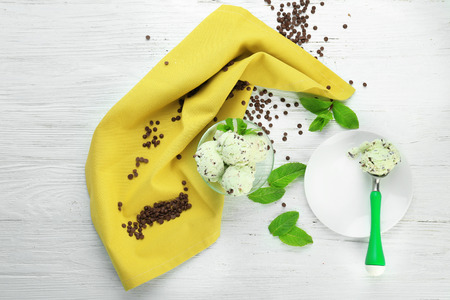 Composition with mint chocolate chip ice cream on white wooden table Imagens