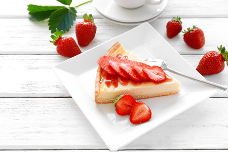 Piece of homemade cake with strawberries on plate Stock Photo