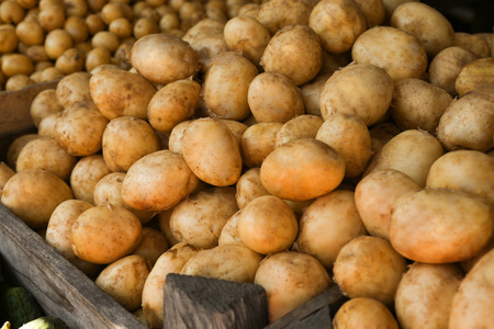 Pile of new potatoes in grocery store, close up Stock Photo