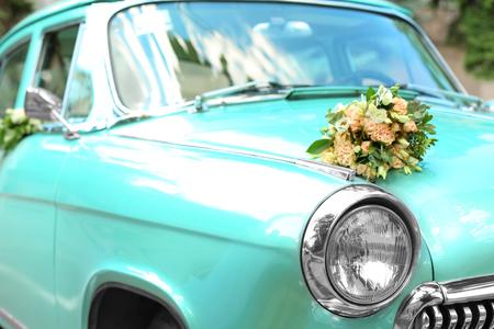 Beautiful floral decoration on wedding car