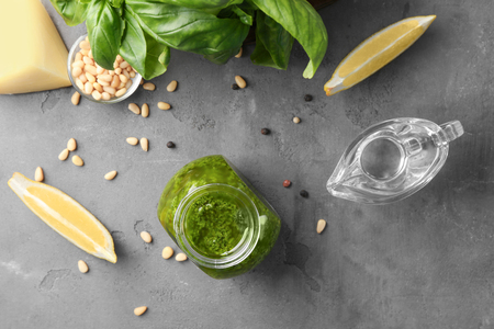 Composition with delicious sauce and ingredients on grunge background 版權商用圖片