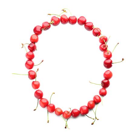 Circle made of fresh cherries on white background