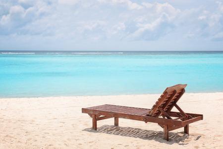 Sun lounger on beach at sea resort