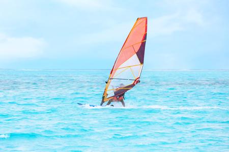 Tourist windsurfing at sea resort