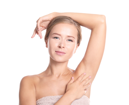 Beautiful young woman in towel on white background. Concept of using deodorant