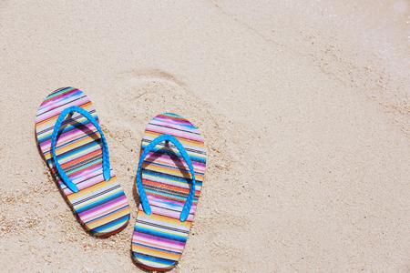 Flip-flops on beach sand. Summer vacation concept