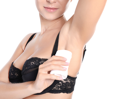 Beautiful young woman with deodorant on white background Stock Photo