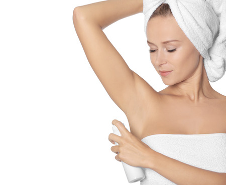 Beautiful young woman with deodorant on white background Stok Fotoğraf