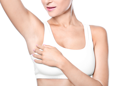 Beautiful young woman on white background. Concept of using deodorant Stockfoto