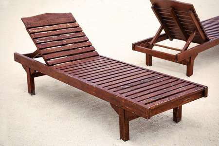 Sun loungers on beach in summer day 写真素材