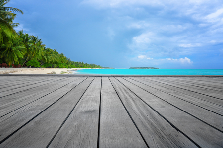 View of tropical beach from wooden pontoon on summer day Imagens