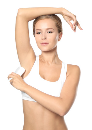 Beautiful young woman with deodorant on white background Banque d'images