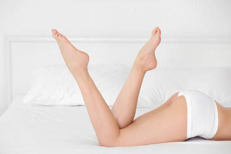 Young woman in underwear on bed Stockfoto