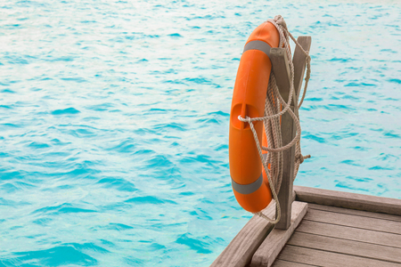 Wooden pontoon with flotation ring at sea resort in summer day Imagens
